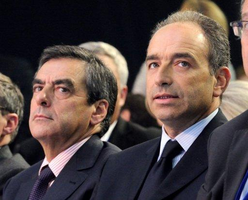Francois Fillon (L), and his opponent Jean-Francois Cope are pictured on September 27, 2012