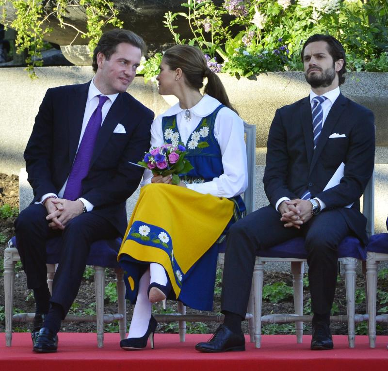Swedish Princess Madeleine, center, her fiancée, New York banker Chris O'Neill, left, and her brother Prince Carl Philip seen during the traditional National Day celebrations at Skansen in Stockholm, Thursday June 6, 2013.    (AP Photo/Scanpix Sweden/Henrik Montgomery)  **  SWEDEN OUT  **