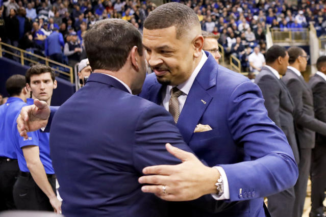 Pittsburgh head coach Jeff Capel, right, greets Duke head coach Mike Krzyzewski before the start of an NCAA college basketball game, Tuesday, Jan. 22, 2019, in Pittsburgh. Capel worked as an assistant under Krzyzewski before taking over as head coach at Pitt this season. (AP Photo/Keith Srakocic)