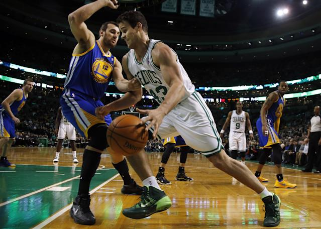 Boston Celtics center Kris Humphries (43) drives against Golden State Warriors center Andrew Bogut (12) in the first half of an NBA basketball game in Boston, Wednesday, March 5, 2014. (AP Photo/Elise Amendola)