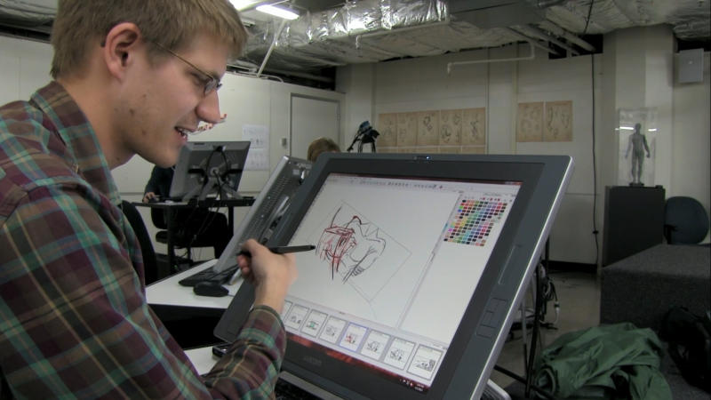 "This photo provided by 2K Games shows a student drawing an illustration in the film, ""The Art of the Game."" 2K Games commissioned filmmaker Matthew Davis Walker and his production company Story Developing to create the feature-length documentary, set to debut for free Thursday, May 8, 2014, on Machinima's Twitch.tv channel and later on Xbox Live and YouTube. The film chronicles budding game designers at the Academy of Art University in San Francisco who competed last year for an internship at 2K by creating short computer-generated films set in the fictional realm from the ""Borderlands"" games. (AP Photo/2K Games)"