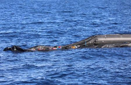 A Boat That Was Carrying Immigrants Is Seen In The Mediterranean Sea Off Coast Of