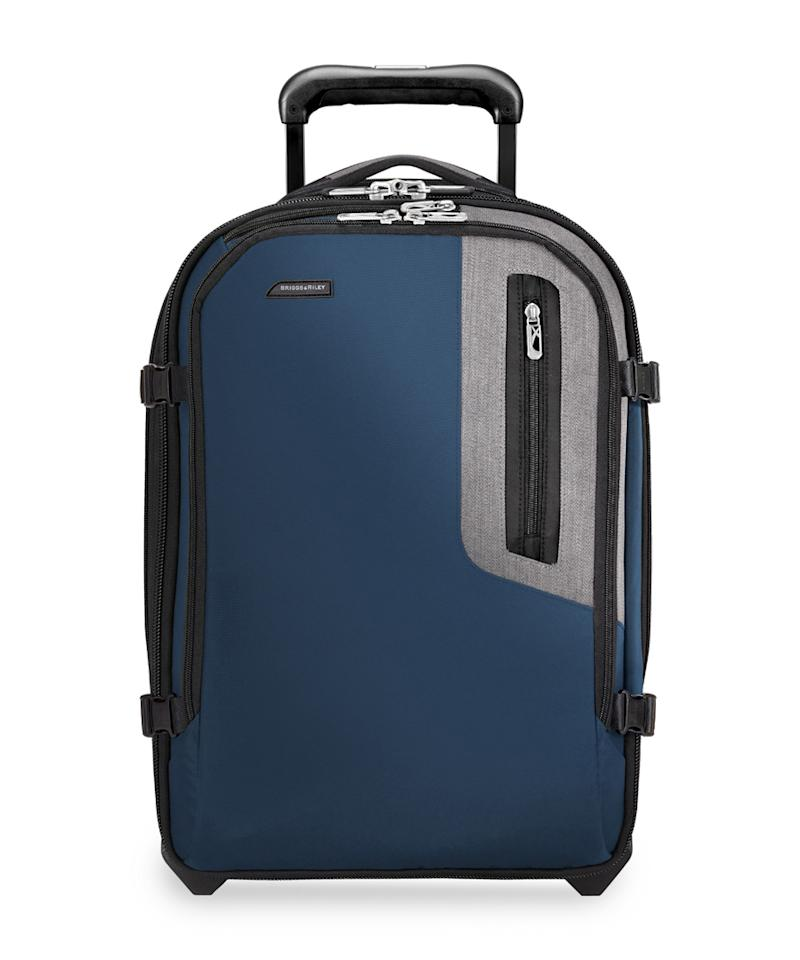 """<p>At $300, the Briggs & Riley Explore Expandable Commuter Upright is a little more expensive than the other bags in this roundup, but it is also one of the lightest larger carry-ons you can buy. It weighs in at just under seven pounds. It's also equipped with exterior pockets that make it perfect for international travel or business travelers that don't carry a purse. It looks a little less sleek than some of the hard-side options above, but its durability and practicality are almost unmatched with any other comparably priced carry-on.</p>  <p>Explore Expandable Commuter Upright available at <a rel=""""nofollow"""" href=""""https://ec.yimg.com/ec?url=http%3a%2f%2fwww.briggs-riley.com%2fshop%2fcollections%2fbrx%2fexplore-expandable-commuter-upright%26quot%3b%26gt%3bbriggs-riley.com%26lt%3b%2fa%26gt%3b&t=1508656528&sig=.Wv0ZcOg70LRyT2IppmCBg--~D 