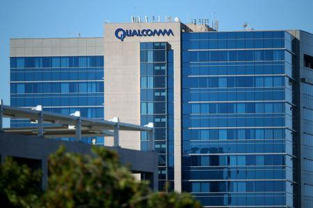 FILE PHOTO - The Qualcomm logo is seen on one of its buildings in San Diego, California