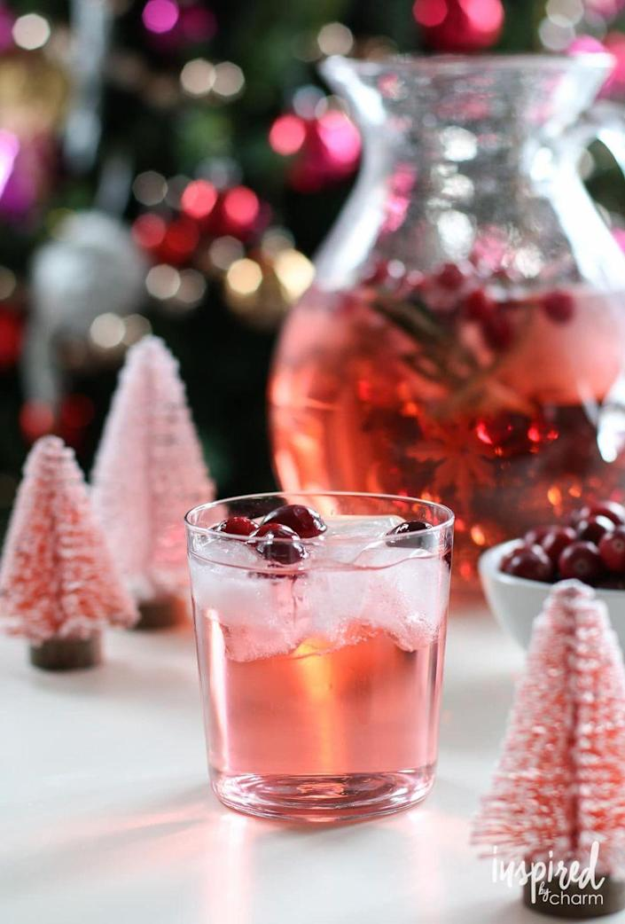 """<p>Just combine vodka, pink champagne, and cherry 7-Up to make this picture-perfect cocktail. The cranberry and rosemary ice cubes are a simple added touch.</p><p><strong>Get the recipe at <a href=""""https://inspiredbycharm.com/jingle-juice-holiday-punch/"""" rel=""""nofollow noopener"""" target=""""_blank"""" data-ylk=""""slk:Inspired by Charm"""" class=""""link rapid-noclick-resp"""">Inspired by Charm</a>.</strong> </p><p><a class=""""link rapid-noclick-resp"""" href=""""https://go.redirectingat.com?id=74968X1596630&url=https%3A%2F%2Fwww.walmart.com%2Fsearch%3Fq%3Dice%2Bcube%2Btrays&sref=https%3A%2F%2Fwww.thepioneerwoman.com%2Ffood-cooking%2Fmeals-menus%2Fg34703383%2Fchristmas-punch-recipes%2F"""" rel=""""nofollow noopener"""" target=""""_blank"""" data-ylk=""""slk:SHOP ICE CUBE TRAYS"""">SHOP ICE CUBE TRAYS </a></p>"""