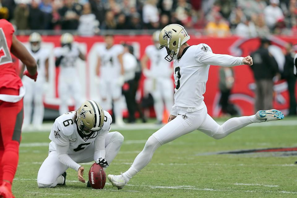 Wil Lutz (3) kicks a field goal from the hold of punter Thomas Morstead (6)