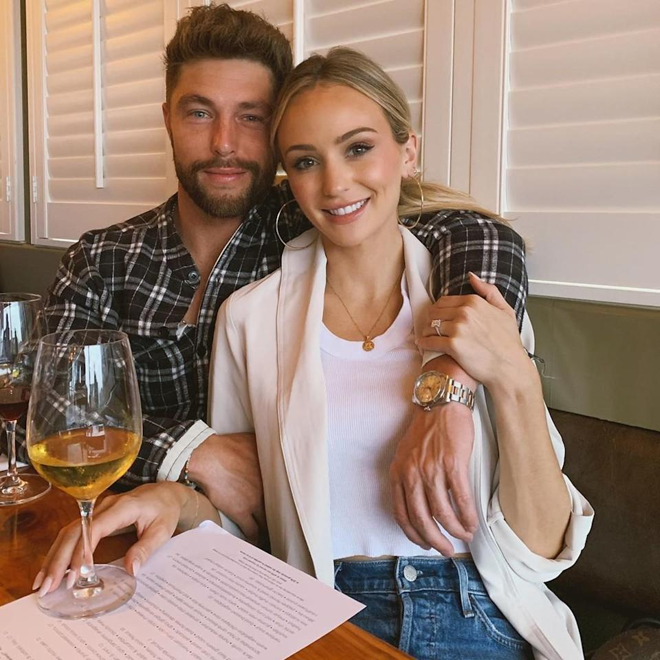 """With fiancé Chris Lane's arm in one hand and a <a href=""""https://www.instagram.com/p/B0yipDKAjv-/"""">glass of white</a> in the other, this <em>Bachelor</em> alum is living the sweet life."""