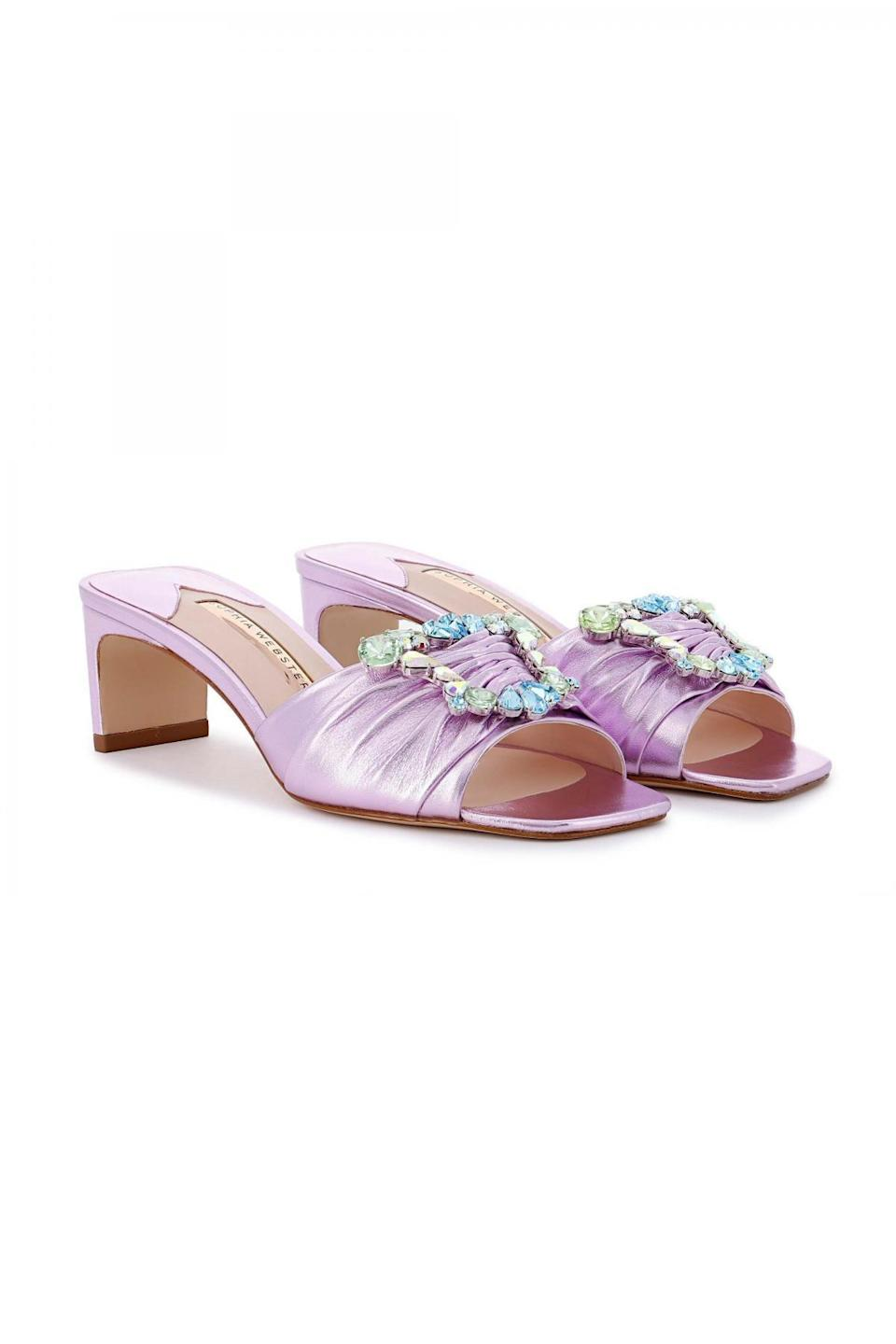 """<p><strong>Sophia Webster</strong></p><p>sophiawebster.com</p><p><strong>$695.00</strong></p><p><a href=""""https://www.sophiawebster.com/product/32585/margaux-mule"""" rel=""""nofollow noopener"""" target=""""_blank"""" data-ylk=""""slk:Shop Now"""" class=""""link rapid-noclick-resp"""">Shop Now</a></p><p>Icy pink ruching and crystal buckles feel like something Cher Horowitz would throw on in 2021 to meet Dionne at The Ivy for a drink.</p>"""