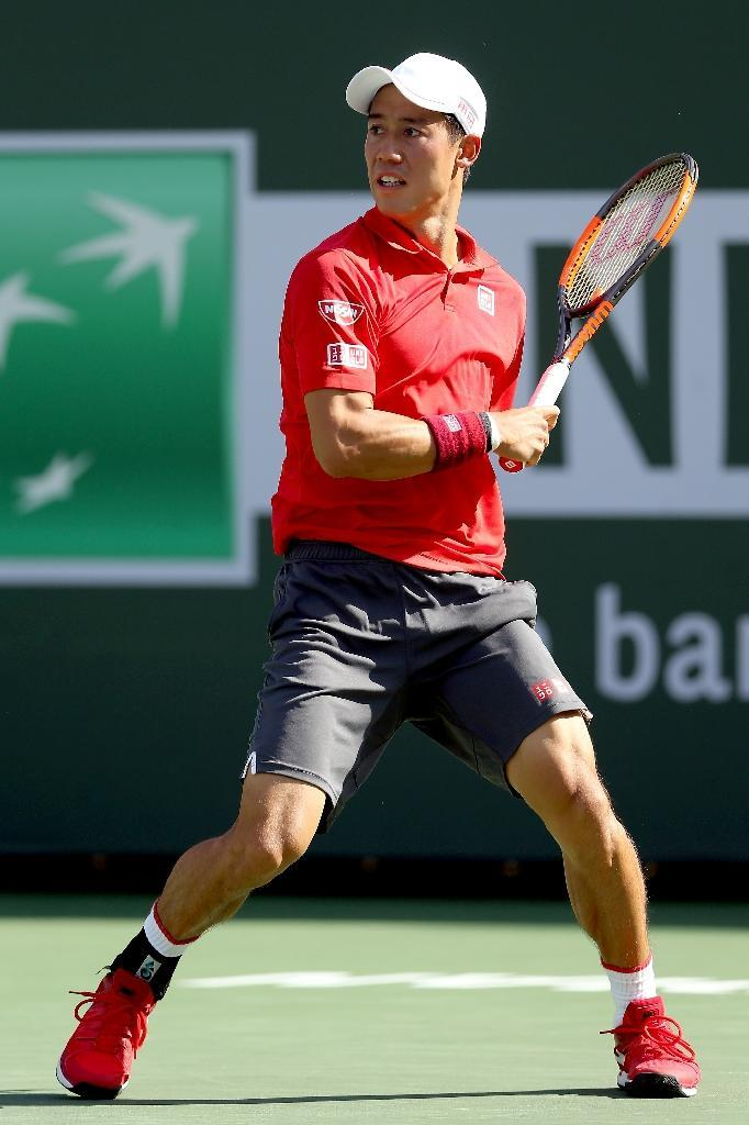 Kei Nishikori of Japan returns a shot to Jack Sock of the US during their BNP Paribas Open quarter-final match, at the Indian Wells Tennis Garden in California, on March 17, 2017 (AFP Photo/Matthew Stockman)