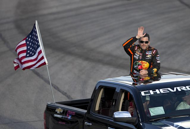 Sprint Cup Series driver Tony Stewart waves to the crowd before the start of the NASCAR Sprint Cup auto race at Atlanta Motor Speedway Sunday, Aug. 31, 2014, in Hampton, Ga. Stewart was racing for the first time since being involved in a fatal dirt track accident in upstate New York. (AP Photo/John Bazemore)