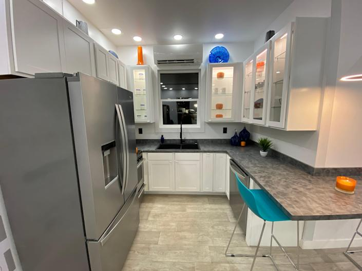 the kitchen with a fridge, countertop, the dining area, sink, storage