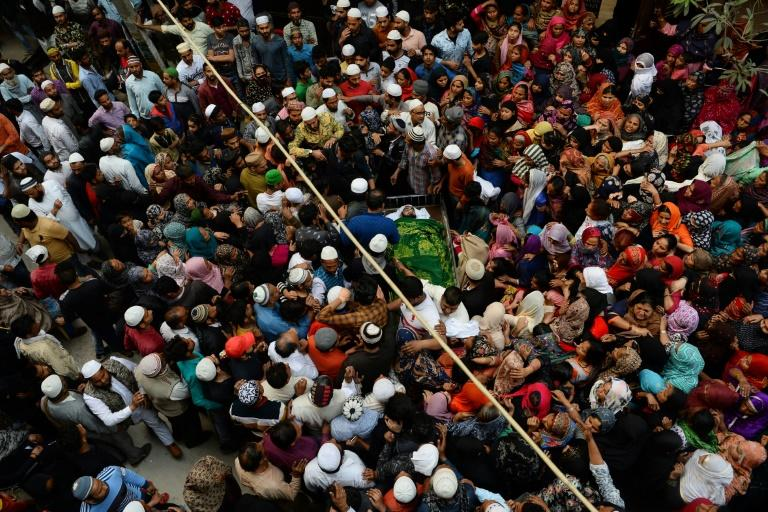Relatives, friends and residents gather on February 27 in New Delhi for the funeral of 31-year-old Mohammad Mudasir, who died in the recent sectarian riots in India's capital