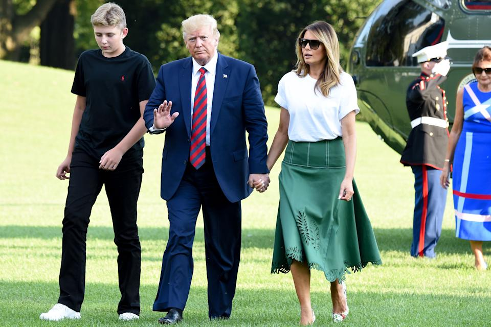 US President Donald Trump, First Lady Melania Trump and their son Barron Trump return to the White House after two weeks spent at Trump's golf club in New Jersey on August 18, 2019 in Washington, DC.