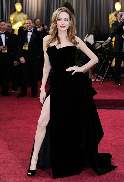 # Angelina's Leg Angelina Jolie flashed some leg on the Oscars red carpet and the image soon took on a meme life of its own.