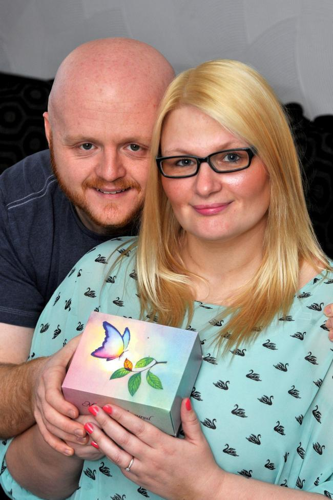 Amanda Gordon and her partner Robert are now calling for more funding into miscarriage research [Photo: SWNS]