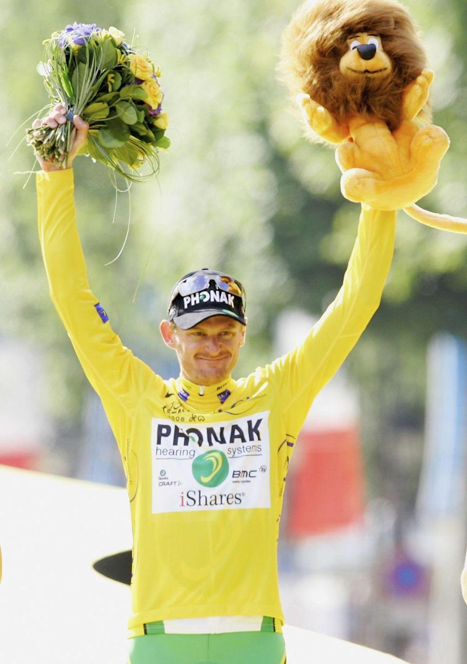 """<p>A year after <a href=""""https://www.bicycling.com/culture/a32660148/lance-armstrong-espn-30-for-30-documentary-part-i/"""" rel=""""nofollow noopener"""" target=""""_blank"""" data-ylk=""""slk:Lance Armstrong"""" class=""""link rapid-noclick-resp"""">Lance Armstrong</a>'s retirement, it looked like the trend of American winners might continue when Floyd Landis took the yellow jersey on Stage 11. But just two stages later, the longest stage of the Tour on a boiling hot day in southern France, Landis lost the lead in stunning fashion to what the Italians call a <em>fuga bidone</em>: a long, innocent-looking break that contains a high-quality rider.</p><p>Landis would regain the lead on Stage 15 on the Alpe d'Huez finish, but the next day, Landis suffered a shocking 10-minute crack on the summit finish to la Toussuire and dropped out of the top 10.</p><p>What happened on Stage 17 should've been the stuff of legend: Landis set his team on the front on the first big climb, more than 100 kilometers from the finish. With the group whittled down, he launched a solo attack, catching up to and eventually dropping the early breakaway and powering over four summits to the finish in Morzine almost six minutes ahead of the chase. The raid vaulted him back to third overall, just 30 seconds behind Oscar Pereiro, the leader at the time. Landis regained yellow only on the penultimate time trial despite a valiant defense by Pereiro, and rode triumphantly to Paris with one of the slimmest leads in race history—57 seconds.</p><p>Then, days later, disaster: a positive test for testosterone. Landis denied and fought the charge, but ultimately lost his title and was banned for two years; Pereiro was declared the winner. The sport essentially shunned Landis even after his ban elapsed, which set in motion the fateful turn of events years later that would result in Armstrong's own downfall and life ban for doping.</p>"""