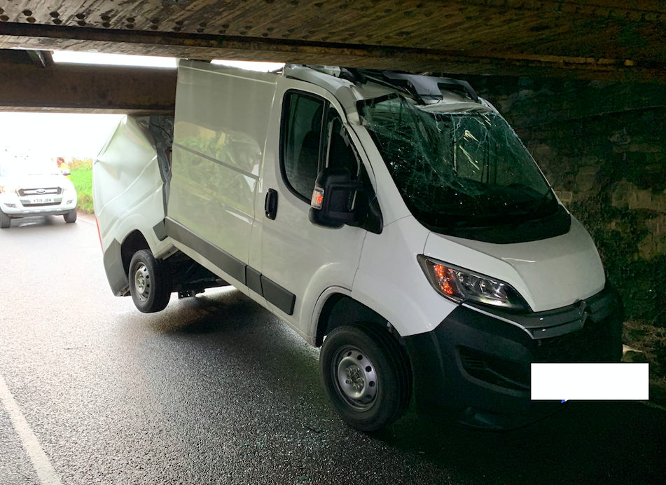 The white Citroen van hit the bridge in Cambridgeshire on Tuesday morning (SWNS)