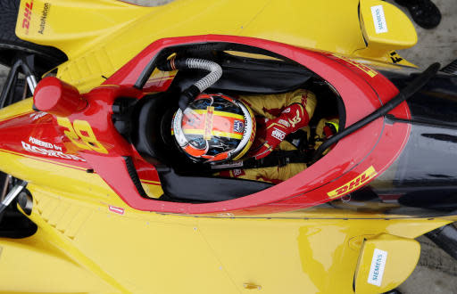 IndyCar driver Ryan Hunter-Reay adjusts his helmet as he prepares to drive in IndyCar Series Open Testing, Wednesday, Feb. 12, 2020, in Austin, Texas. (AP Photo/Eric Gay)