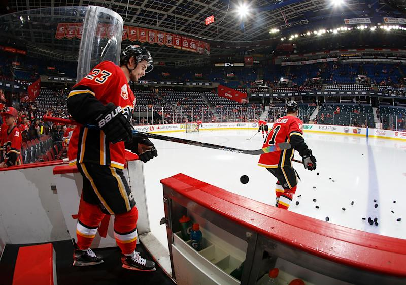 CALGARY, AB - MARCH 6: Sean Monahan #23 of the Calgary Flames heads out on to the ice for warm up against the Arizona Coyotes at Scotiabank Saddledome on March 6, 2020 in Calgary, Alberta, Canada. (Photo by Gerry Thomas/NHLI via Getty Images)