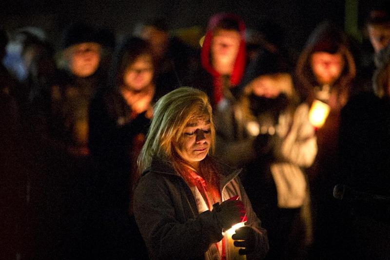 In a Sunday, Nov. 25, 2012 photo, Rachel Brady, sister of Nick Brady, and cousin of Haile Kifer, who were shot and killed during an alleged break in on Thanksgiving Day, speaks about her brother to a crowd who gathered for a vigil in Little Falls, Minn. Byron David Smith, 64, of Little Falls, told police he shot Kifer, 18, and Brady, 17, during a break-in Thursday. But authorities said his actions exceeded reasonable self-defense and planned to charge him Monday with second-degree murder. (AP Photo/The Star Tribune, Renee Jones Schneider) MANDATORY CREDIT; ST. PAUL PIONEER PRESS OUT; MAGS OUT; TWIN CITIES TV OUT