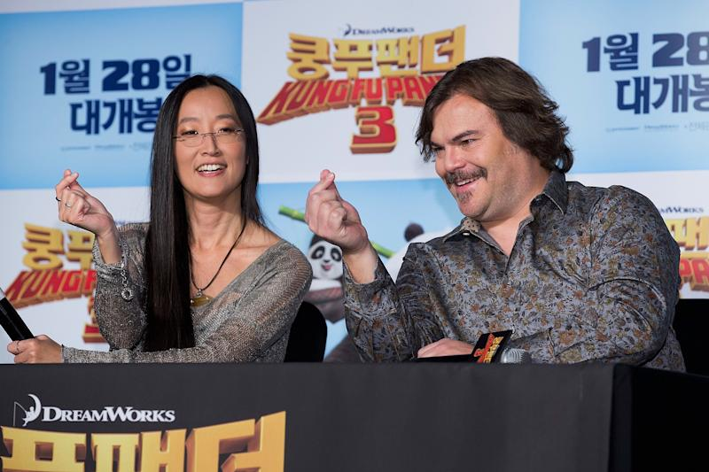 """Kung Fu Panda 3"" director Jennifer Yuh shows actor Jack Black how to form a proper finger heart at a 2016 press event."
