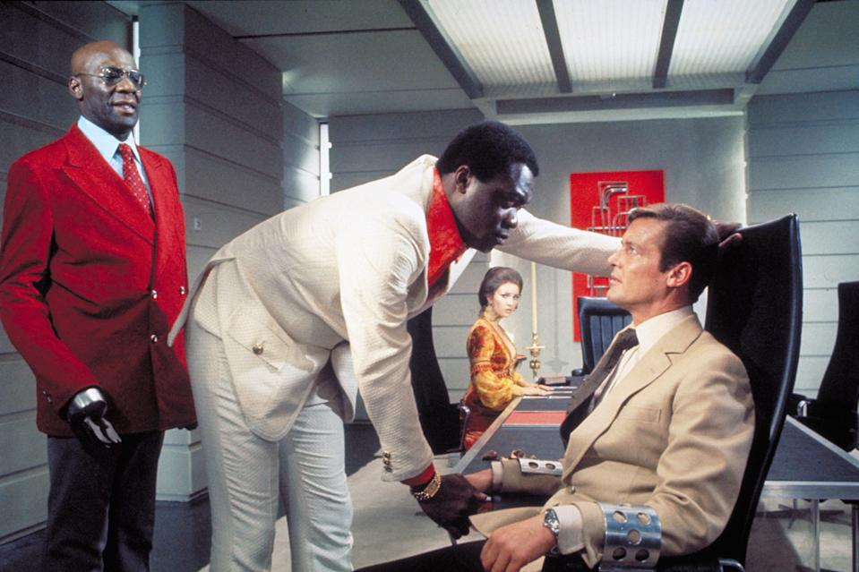 Actors Roger Moore, Yaphet Kotto, Julius W.Harris and actress Jane Seymour, on the set of