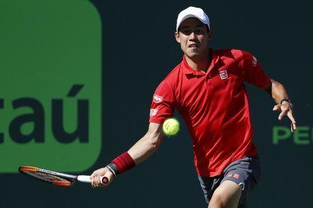Mar 29, 2017; Miami, FL, USA; Kei Nishikori of Japan hits a forehand against Fabio Fognini of Italy (not pictured) on day nine of the 2017 Miami Open at Crandon Park Tennis Center. Fognini won 6-4, 6-2. Geoff Burke-USA TODAY Sports