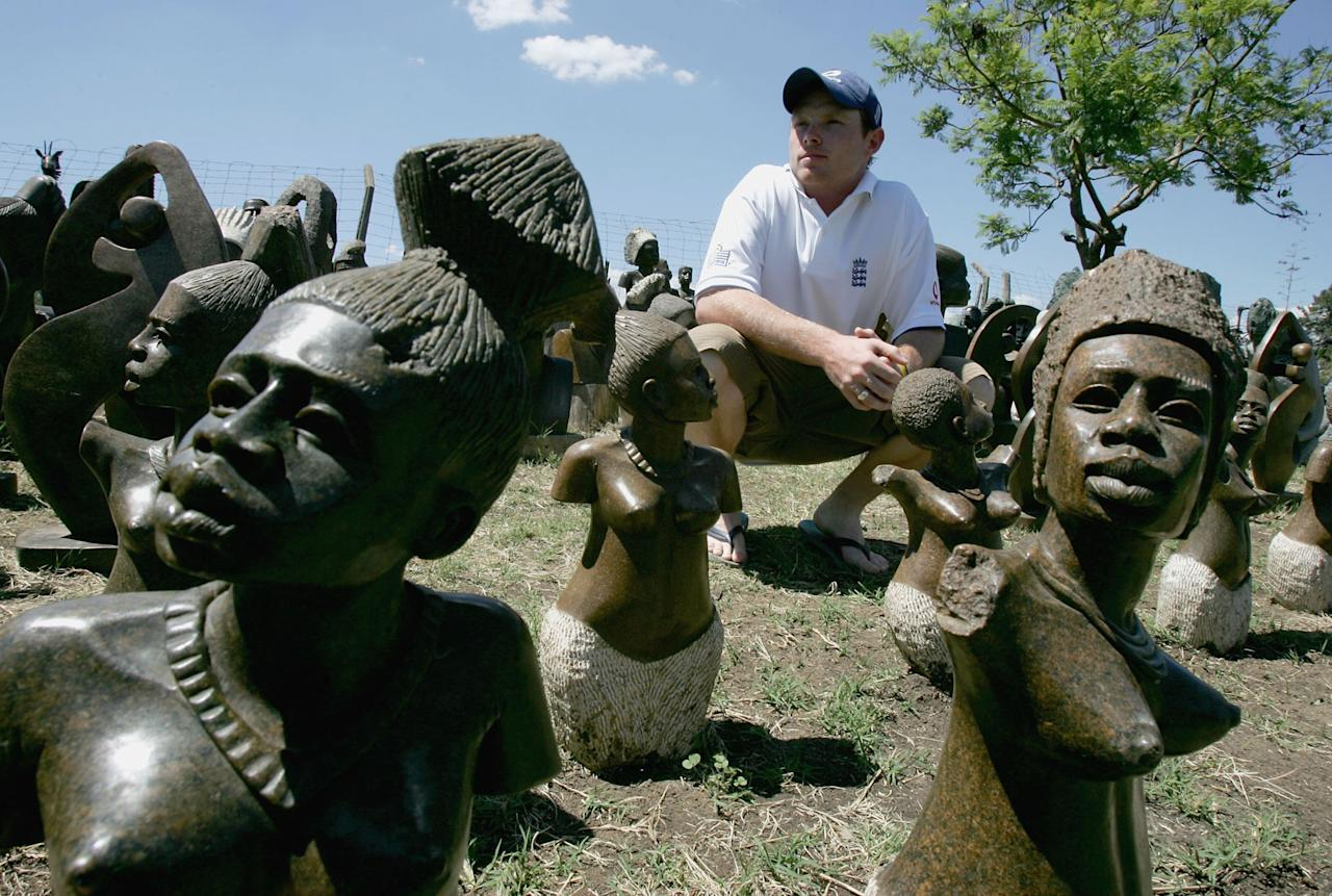 HARARE, ZIMBABWE - NOVEMBER 29: Ian Bell of England takes a close look at some street art at a local street market prior to the 2nd One Day International against Zimbabwe on November 29, 2004 in Harare, Zimbabwe. (Photo by Clive Rose/Getty Images)   *** Local Caption *** Ian Bell