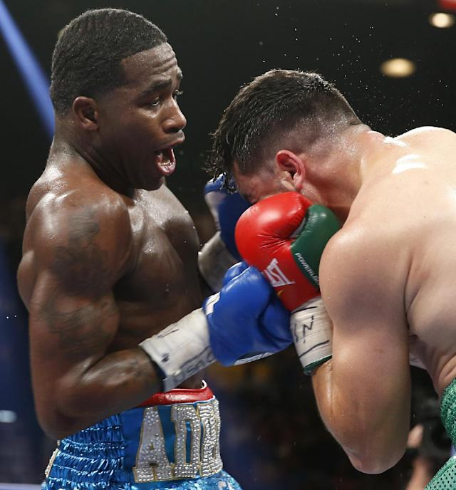 Adrien Broner, left, from Cincinnati, Ohio, lands a right to the head of Carlos Molina, from Norwalk, Calif., in their WBA super lightweight title boxing fight Saturday, May 3, 2014, in Las Vegas. (AP Photo/Eric Jamison)