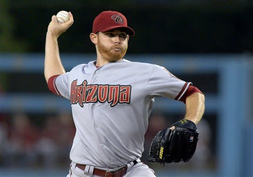 Arizona Diamondbacks starting pitcher Ian Kennedy throws to the plate during the first inning of their baseball game against the Los Angeles Dodgers, Thursday, Aug. 30, 2012, in Los Angeles. (AP Photo/Mark J. Terrill)