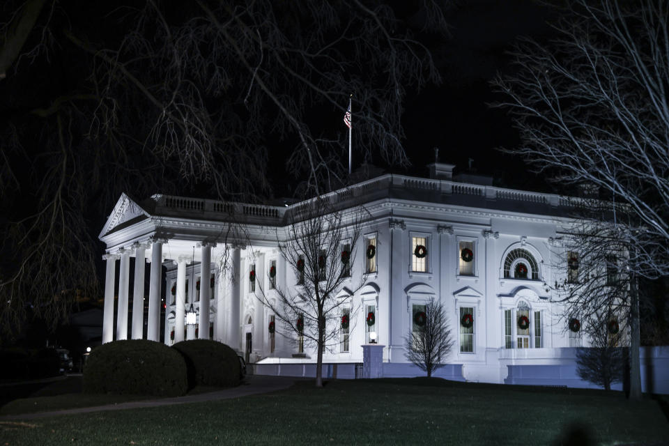 White House lit against the night sky