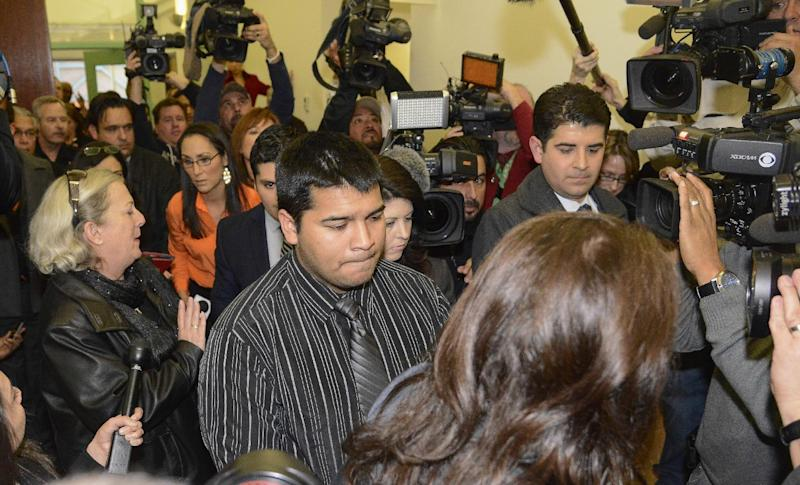 Erick Munoz, husband of Marlise Munoz, is escorted out of court by his attorney Heather L. King, right, Friday, Jan. 24, 2014 in Fort Worth, Texas. The court ruled in Munoz's favor and to remove his brain-dead pregnant wife from life support. Judge R. H. Wallace Jr. issued the ruling in the case of Marlise Munoz. John Peter Smith Hospital in Fort Worth has been keeping Munoz on life support against her family's wishes. The judge gave the hospital until 5 p.m. CST Monday to remove life support. (AP Photo/Tim Sharp)