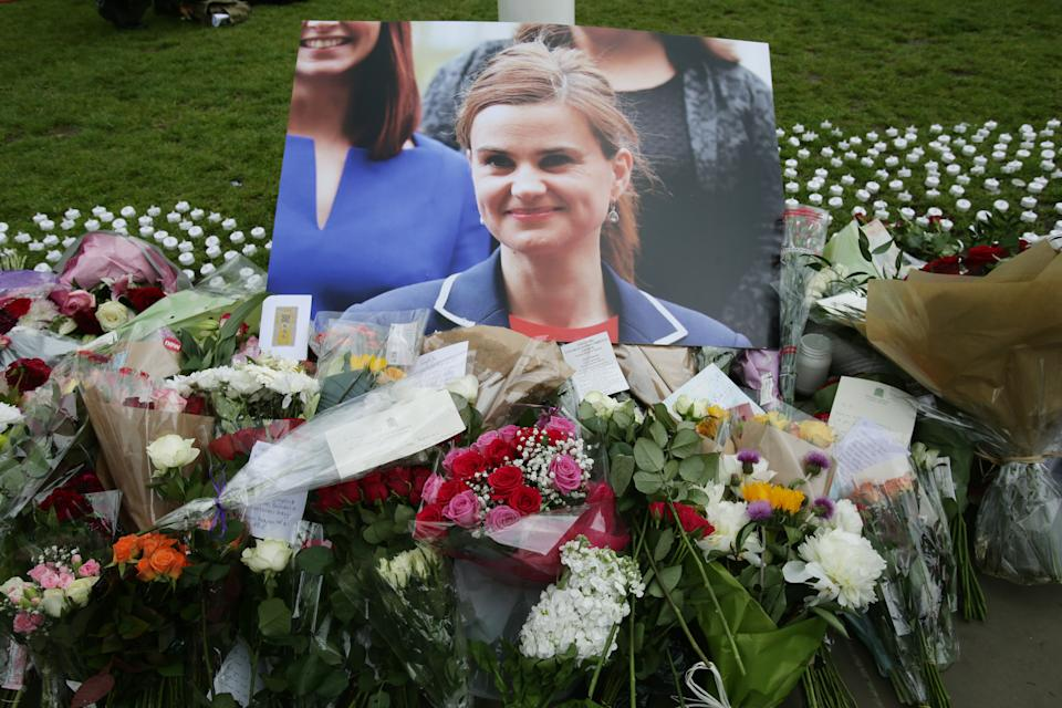 Floral tributes left in Parliament Square, London, after Labour MP Jo Cox was shot and stabbed to death in the street outside her constituency advice surgery in Birstall, West Yorkshire.
