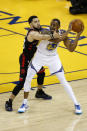 Andre Iguodala #9 of the Golden State Warriors is defended by Fred VanVleet #23 of the Toronto Raptors in the first half during Game Three of the 2019 NBA Finals at ORACLE Arena on June 05, 2019 in Oakland, California. (Photo by Lachlan Cunningham/Getty Images)