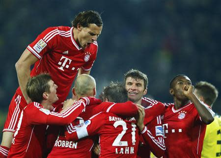 Bayern Munich's players celebrate vicotry against Borussia Dortmund during their German first division Bundesliga soccer match in Dortmund, November 23, 2013. REUTERS/Kai Pfaffenbach