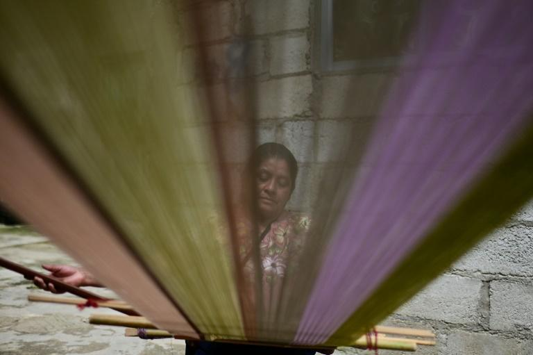 The weavers seek international recognition of their tradition, culture and fabrics (AFP/PEDRO PARDO)