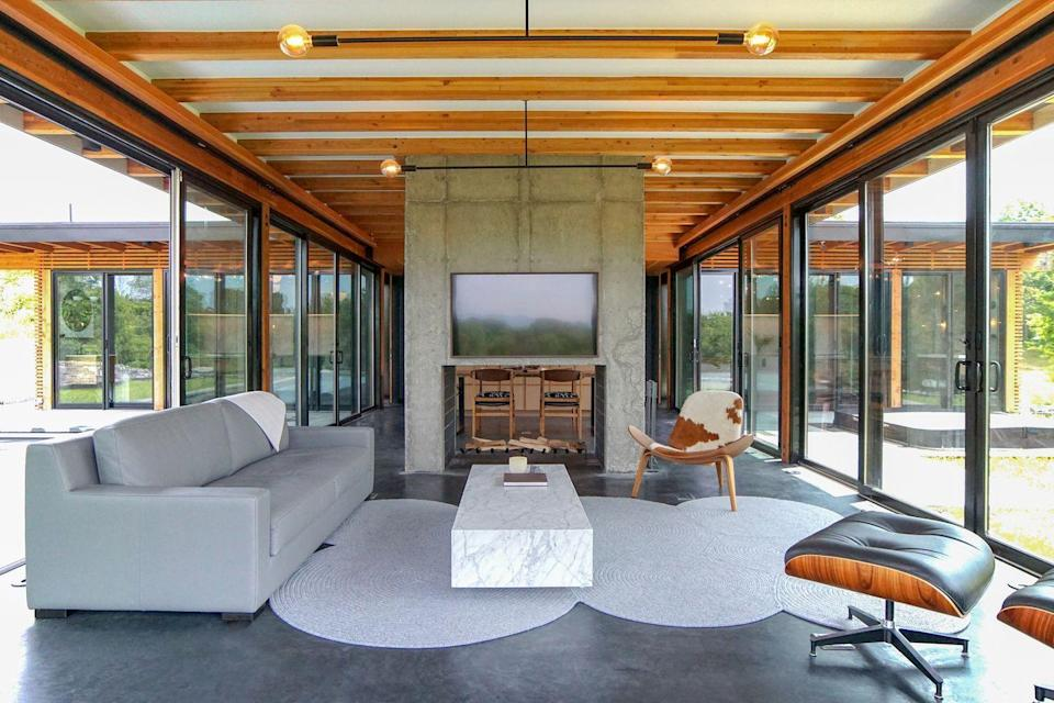 """<p>Inspired by 1950s Case Study Program designs, architect Mark Bearek sought to bring California modernism to the East Coast with this <a href=""""https://www.airbnb.com/rooms/38125330?source_impression_id=p3_1617820716_Ua54PT%2B%2BqPZqTj0R&guests=1&adults=1"""" rel=""""nofollow noopener"""" target=""""_blank"""" data-ylk=""""slk:Hudson house"""" class=""""link rapid-noclick-resp"""">Hudson house</a>. The glass home melds indoors and outdoors with views of the surrounding mountains; a pool, complete with an underwater bench; a hot tub; a custom concrete fireplace; and exposed Douglas fir detailing throughout for a rustic-meets-industrial feel.</p><p><a class=""""link rapid-noclick-resp"""" href=""""https://www.airbnb.com/rooms/38125330"""" rel=""""nofollow noopener"""" target=""""_blank"""" data-ylk=""""slk:Book Now"""">Book Now</a></p>"""
