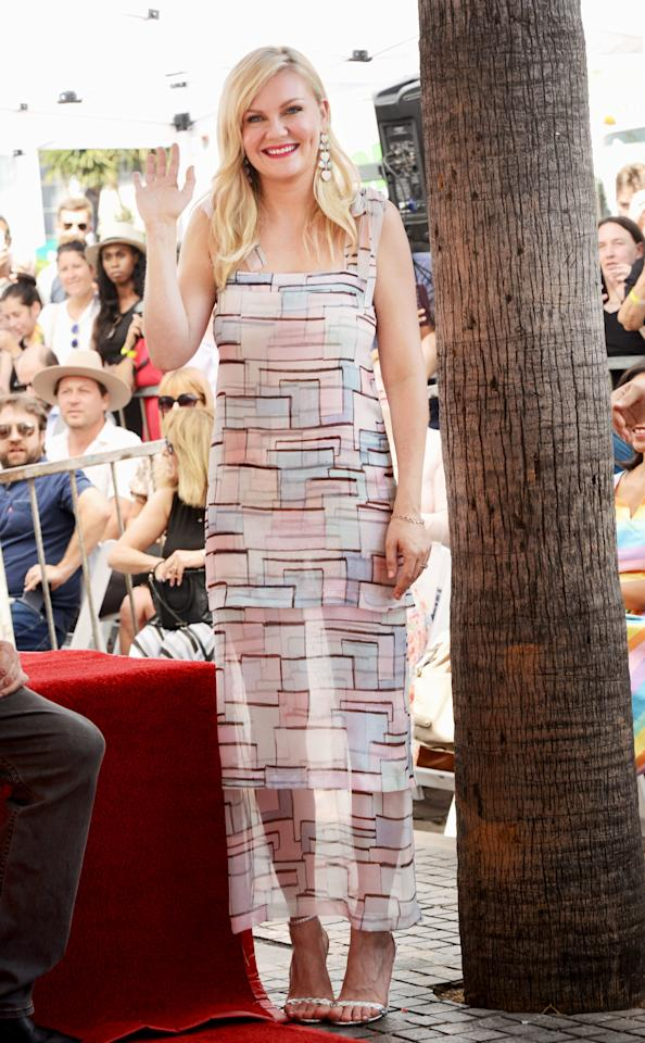 wears a sheer geometric-print tank dress as she's being honored with astar on the Hollywood Walk of Fame in Hollywood.