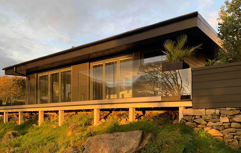 """<strong><a href=""""http://airbnb.pvxt.net/a11o2b"""" rel=""""nofollow noopener"""" target=""""_blank"""" data-ylk=""""slk:Twmbarlwm Luxury Retreat, Gwent, Wales"""" class=""""link rapid-noclick-resp"""">Twmbarlwm Luxury Retreat, Gwent, Wales </a></strong><br><br>This holiday cabin has been built discretely into the south Wales hills. It's located on a working farm with its own wildlife pond, and also benefits from WiFi.<br><br><em>From £131 per night</em>"""