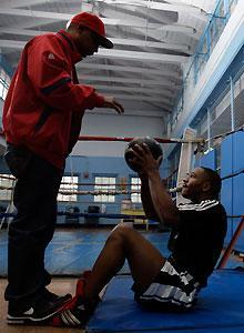 Devon Alexander (R) is the star example of Kevin Cunningham's (L) vision for bringing underprivileged youths off the street and into boxing
