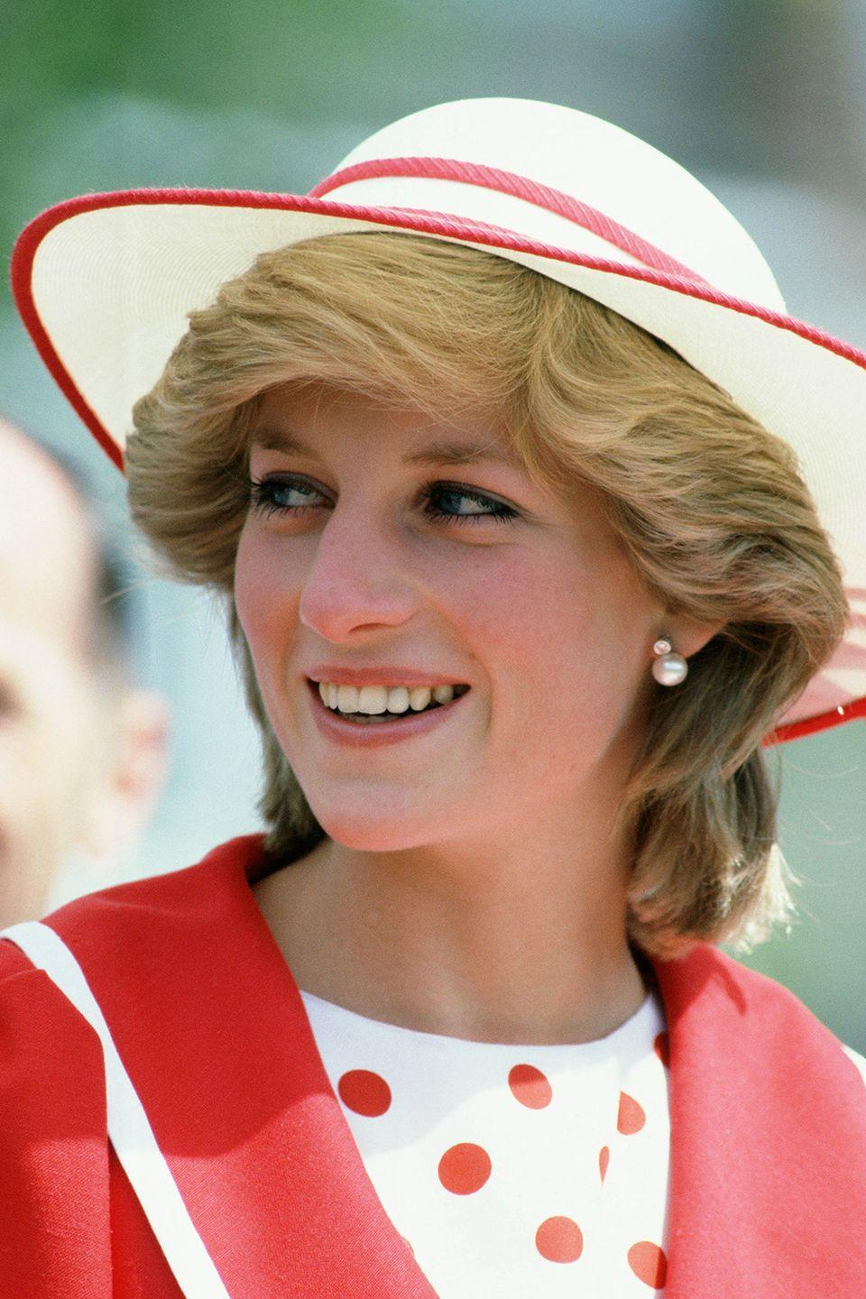 <p>In a jaunty red-and-white hat while visiting Canada.</p>