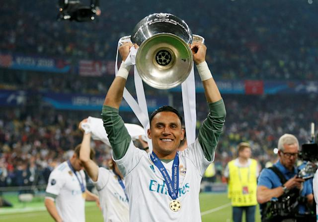 Soccer Football - Champions League Final - Real Madrid v Liverpool - NSC Olympic Stadium, Kiev, Ukraine - May 26, 2018 Real Madrid's Keylor Navas celebrates with the trophy after winning the Champions League REUTERS/Gleb Garanich