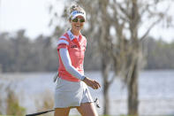 Nelly Korda smiles at fans walking up the 18th fairway during the Gainbridge LPGA golf tournament Sunday, Feb. 28, 2021, in Orlando, Fla. (AP Photo/Stan Badz)