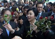 Ousted Thai PM proclaims innocence as criminal trial starts