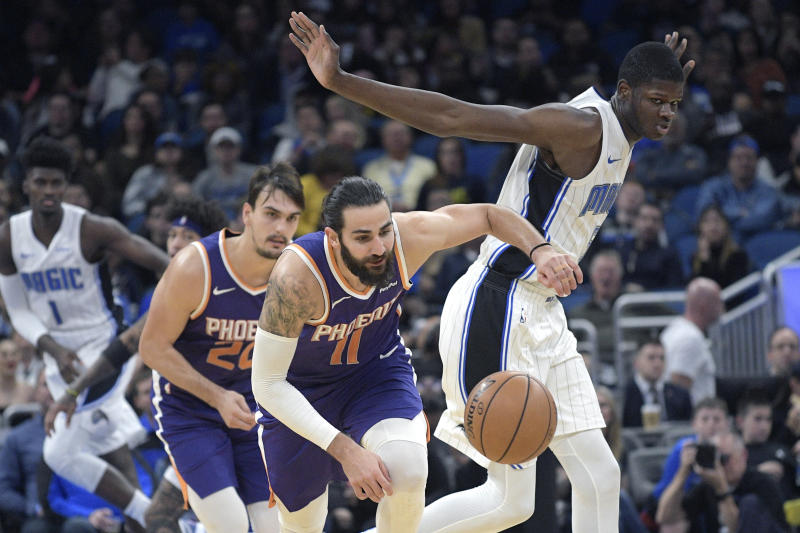Phoenix Suns guard Ricky Rubio (11) steals the ball from Orlando Magic center Mo Bamba, right, during the first half of an NBA basketball game Wednesday, Dec. 4, 2019, in Orlando, Fla. (AP Photo/Phelan M. Ebenhack)