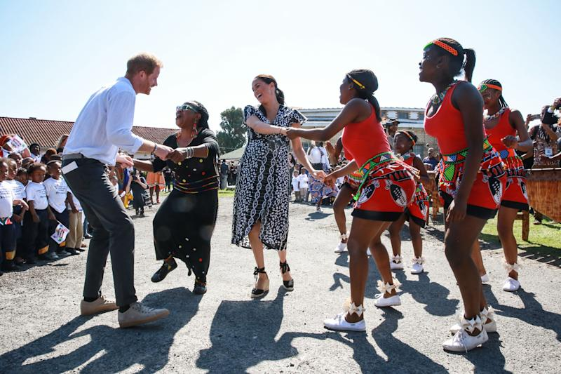 Harry Meghan Markle dance on $450k African tour