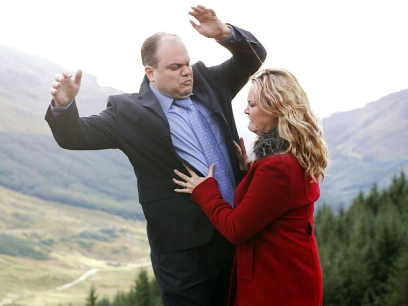 Down he goes: Barry (Shaun Williamson) is pushed off a cliff by his new bride Janine (Charlie Brooks) in a memorable 2003 episode of EastEnders: BBC