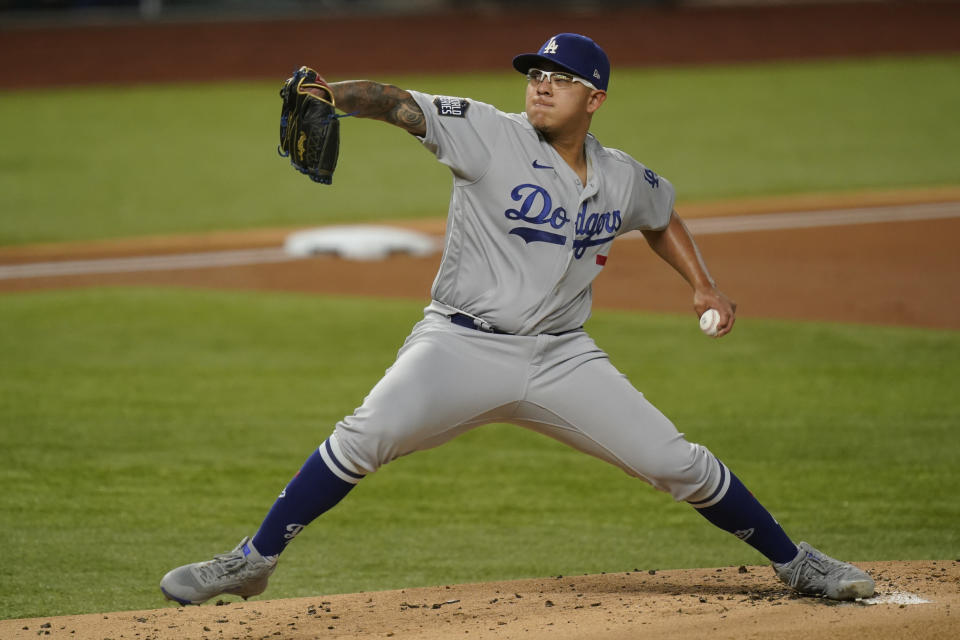 Los Angeles Dodgers starting pitcher Julio Urias throws against the Tampa Bay Rays during the first inning in Game 4 of the baseball World Series Saturday, Oct. 24, 2020, in Arlington, Texas. (AP Photo/Eric Gay)