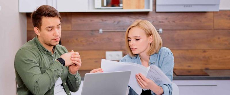 couple comparing mortgage rates sitting together at kitchen table