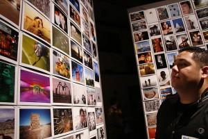 Man staring at panel of Flickr images